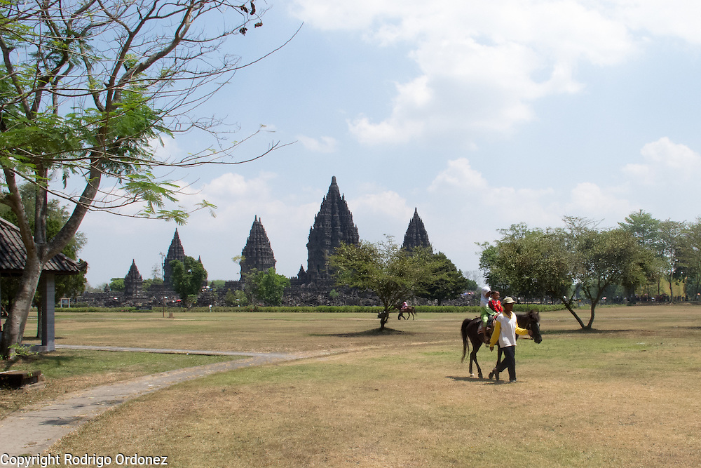 A handler guides a horse on the grounds of Prambanan Temple, also known as Rara Jonggrang complex, in Yogyakarta Special Region, Indonesia.