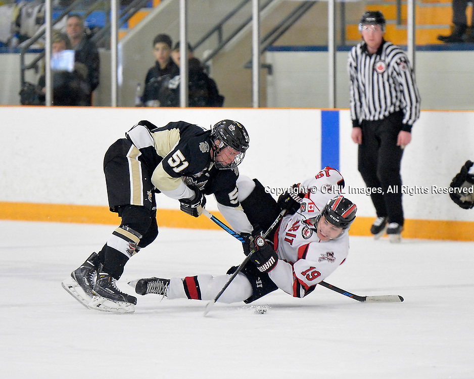 STOUFFVILLE, ON  - MAR 19,  2017: Ontario Junior Hockey League, playoff game between the Trenton Golden Hawks, Stouffville Spirit. Tyler Kulba #19 of the Stouffville Spirit is taken down by Max Ewart #51 of the Trenton Golden Hawks while skating with the puck during the second period.<br /> (Photo by Shawn Muir / OJHL Images)