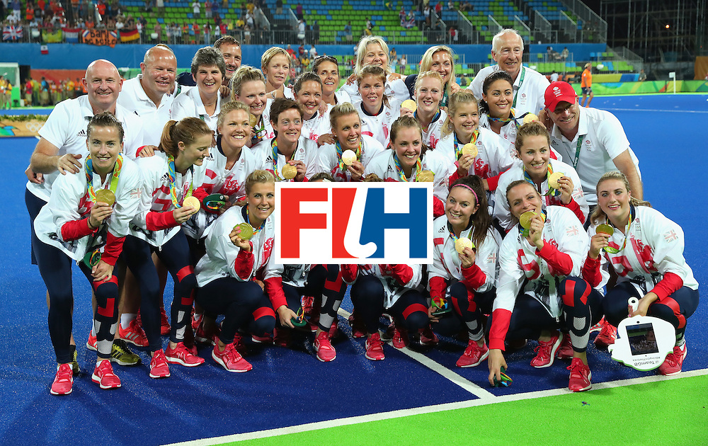 RIO DE JANEIRO, BRAZIL - AUGUST 19:  Team Great Britain pose with their gold medals after defeating Netherlands in the Women's Gold Medal Match on Day 14 of the Rio 2016 Olympic Games at the Olympic Hockey Centre on August 19, 2016 in Rio de Janeiro, Brazil.  (Photo by Tom Pennington/Getty Images)