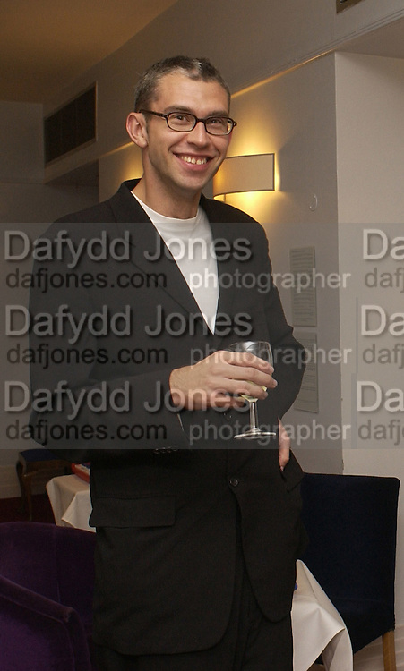 Ernst Malmsten, co-founder of Boo.com, supper at the Groucho club after Bryan Wallick debut concert at Wigmore Hall, 25/9/03 © Copyright Photograph by Dafydd Jones 66 Stockwell Park Rd. London SW9 0DA Tel 020 7733 0108 www.dafjones.com