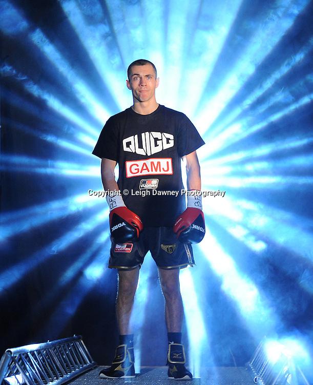 Scott Quigg (black shorts) defeats Jason Booth claiming the British Super Bantamweight Title at the Premier Suite, Reebok Stadium, Bolton, UK on 22.10.11. Frank Maloney Promotions. Photo credit: © Leigh Dawney.