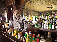Vic Antic, proprietor of the International Cafe and Bar in Austin, Nevada. Vic stands behind a bar that is over 150 years old and one he says was brought over from England by ship in the 19th century. <br /> <br /> /// ADDITIONAL INFORMATION: 5/12/11 - travel.Lincoln.East.0929.sp - STUART PALLEY Lincoln Highway West