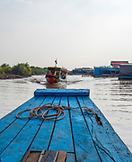 Tourists take boats to the floating village of Kampong Phluk, Cambodia.