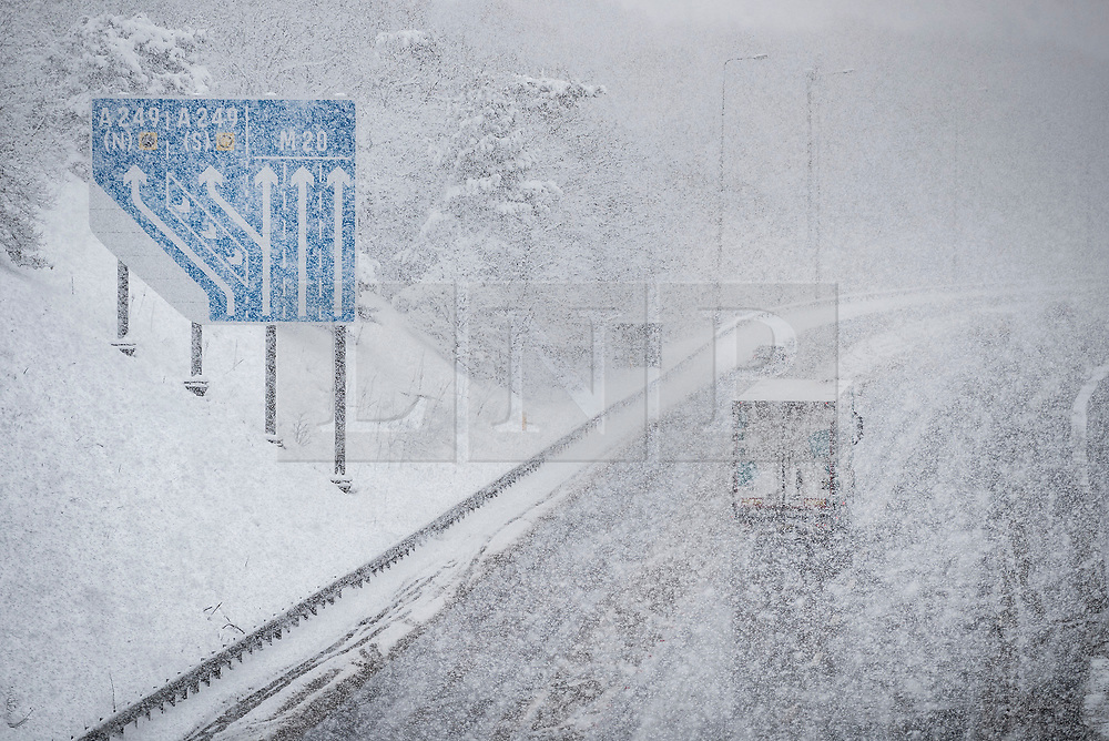 © Licensed to London News Pictures. 27/02/2018. Maidstone, UK.  Near white-out conditions hit the coast-bound M20 north of Maidstone as snow continues to fall. Freezing temperatures and heavy snow are affecting large parts of Kent.  Photo credit: Peter Macdiarmid/LNP