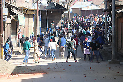 April 14, 2017 - Srinagar, Jammu and Kashmir, India - Kashmiri protesters run for cover as government forces chase them during Anti India protest in Sopore on Friday 14, April 2017. (Credit Image: © Mohammad Abu Bakar/Pacific Press via ZUMA Wire)