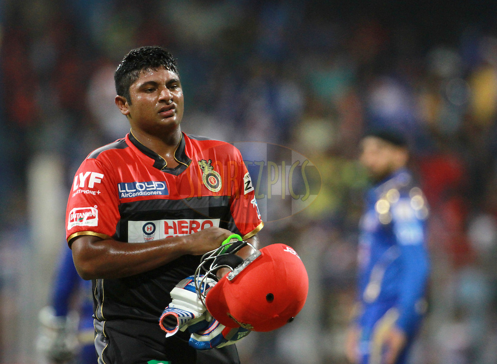 Royal Challengers Bangalore player Sarfaraz Khan walks back to the pavilion after getting out during match 14 of the Vivo Indian Premier League ( IPL ) 2016 between the Mumbai Indians and the Royal Challengers Bangalore held at the Wankhede Stadium in Mumbai on the 20th April 2016<br /> <br /> Photo by Vipin Pawar/ IPL/ SPORTZPICS