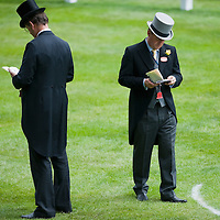 ASCOT, ENGLAND - JUNE 20: Studying the race cardat  the fifth and final day of Royal Week  at Ascot Racecourse on June 20, 2009 in Ascot, England  (Photo by Marco Secchi/Getty Images)