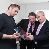 Mathew Griffin, locally based illustrator, showing Michael Ring, TD Minister for Sports some of his work during the Official opening of 'The Castle', Antique, Arts & Craft Centre in Clarecastle