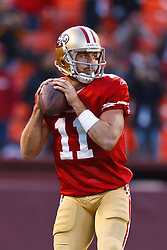 Dec 19, 2011; San Francisco, CA, USA; San Francisco 49ers quarterback Alex Smith (11) warms up before the game against the Pittsburgh Steelers at Candlestick Park. San Francisco defeated Pittsburgh 20-3. Mandatory Credit: Jason O. Watson-US PRESSWIRE