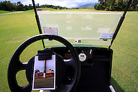 Keeping the score card on the wheel of a golf buggy at the Sea Temple golf course in Port Douglas, far north Queensland, Australia.