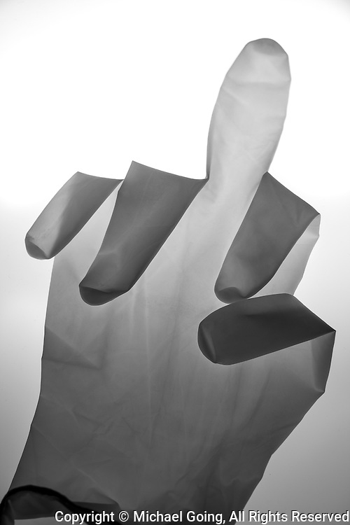 Latex glove giving the finger