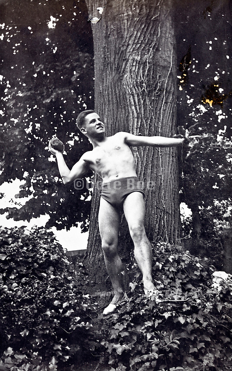 young adult man in swimming trunk standing in throwing sporting pose 1930s Europe