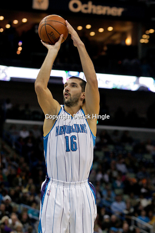 Nov 13, 2009; New Orleans, LA, USA;  New Orleans Hornets forward Peja Stojakovic (16) shoots against the Portland Trail Blazers during the second quarter at the New Orleans Arena. Mandatory Credit: Derick E. Hingle-US PRESSWIRE