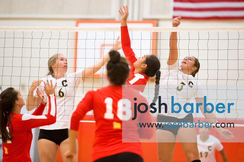 Deeann Schaal, Brittney Pinzon, Hailey Manliguis during a non-league girl's volleyball match between the Canyon Comanches and Rosary Royals at Rosary Academy on Thursday, September 17, 2015 in Fullerton, California.