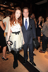 OLIVIA GRANT and RUSSELL BREWER at the Ralph Lauren Wimbledon Party held at Ralph Lauren, 1 New Bond Street, London on 17th June 2010.