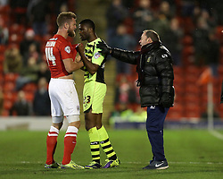 Yeovil Town Manager, Gary Johnson gets involved in a scrap between Barnsley's Scott Wiseman and Yeovil Town's Joel Grant - Photo mandatory by-line: Matt Bunn/JMP - Tel: Mobile: 07966 386802 14/12/2013 - SPORT - Football - Barnsley - Oakwell - Barnsley v Yeovil Town - Sky Bet Championship