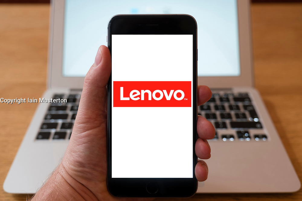 Using iPhone smartphone to display logo of Lenovo Chinese computer hardware company