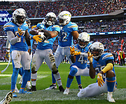 LONDON, ENGLAND - OCTOBER 21: linebacker Denzel Perryman (52) of The Chargers celebrates an interception during the NFL game between Tennessee Titans and Los Angeles Chargers at Wembley Stadium on October 21, 2018 in London, United Kingdom. (Photo by Mitchell Gunn/Pro Lens Photo Agency) *** Local Caption *** <br /> Denzel Perryman
