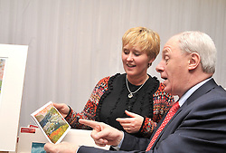 Deborah Joyce Achill based artist & member of Craftworks Mayo offers Michael Ring Minister of State at the Dept of Tourism & Sport one of her cards from dipcting Purteen Harbour, Achill at the Winter Expo that took place at the Wyatt Hotel..Pic Conor McKeown