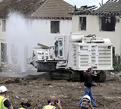 ©  licensed to London News Pictures. 01/07/2011. Gravesend, Kent. Jeremy Clarkson breaks the the water mains with the remote controls of the Armtrac tank type vechicle. Top Gear presenters Jeremy Clarkson, James May and Richard Hammond smashing up old houses in Gravesend, Kent with tanks during filming for Top Gear today (01/07/2011). See special instructions. Photo credit Grant Falvey/LNP.