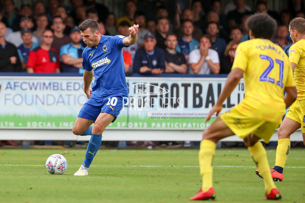 AFC Wimbledon attacker Adam Roscrow (10) about to shoot on goal during the EFL Sky Bet League 1 match between AFC Wimbledon and Wycombe Wanderers at the Cherry Red Records Stadium, Kingston, England on 31 August 2019.