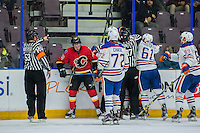 PENTICTON, CANADA - SEPTEMBER 17: Ice officials try to break up a scrum of players on September 17, 2016 at the South Okanagan Event Centre in Penticton, British Columbia, Canada.  (Photo by Marissa Baecker/Shoot the Breeze)  *** Local Caption ***