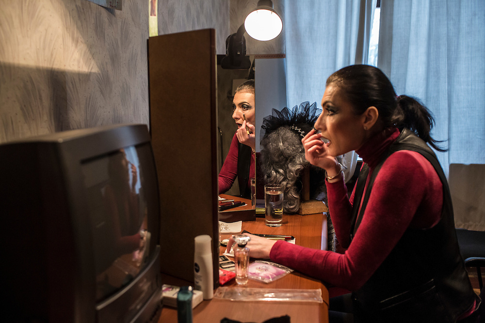Tatyana Sauvina, a mezzo-soprano, applies makeup before a performance of the Masquerade Ball at the Donbass Opera on Saturday, March 26, 2016 in Donetsk, Ukraine.