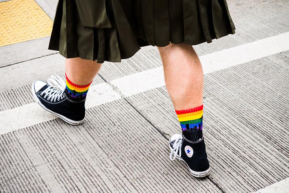 United States, Washington, Seattle Gay Pride Parade, June 28th, 2015. Man wearing rainbow socks and kilt.