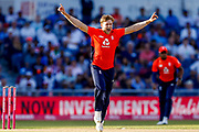 England T20 all rounder David Willey celebrates England T20  first wicket of India T20 batsman Shikhar Dhawan during the International T20 match between England and India at Old Trafford, Manchester, England on 3 July 2018. Picture by Simon Davies.