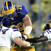Delaware offensive lineman (#79) Nick Cattolico battles West chester (#34) Anthony McCloskey in the fourth quarter as No. 16 Hens would go on to a 31-0 victory in the season opener at Delaware Stadium......
