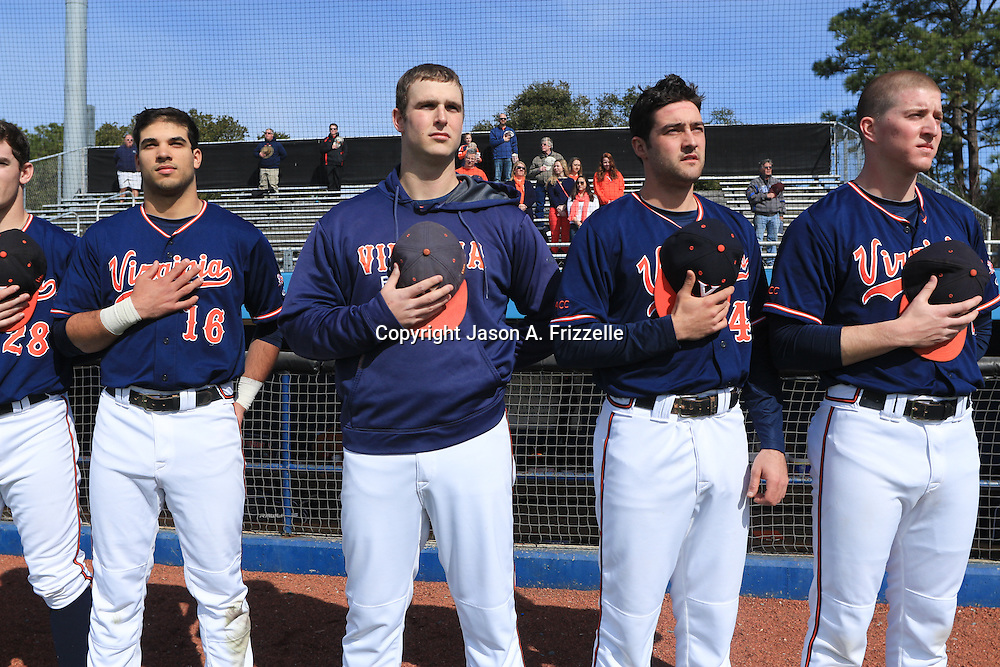 Members of The University of Virginia observe the National Anthem before the start of their season opener against The University of Kentucky. The university of Kentucky faced the University of Virginia in the opening game of the Hughes Brothers Challenge Friday February 14, 2014 at Brooks Field on the campus of the University of North Carolina at Wilmington in Wilmington, N.C. (Jason A. Frizzelle)
