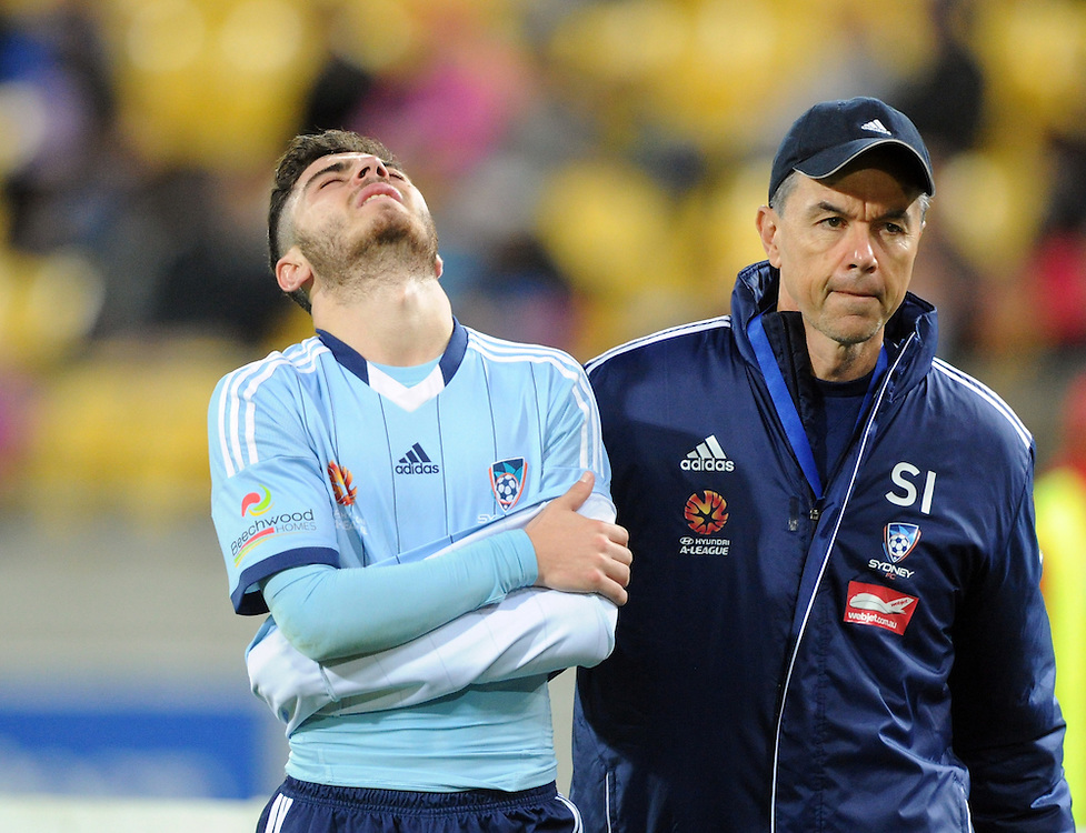 Sydney FC's Christopher Naumoff walks from the field in pain with an arm injury after a off the ball tackle by Phoenix's Michael Bloxall in the A-League football match at Westpac Stadium, Wellington, New Zealand, Sunday, April 26, 2015. Credit:SNPA / Ross Setford