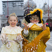 VENICE, ITALY - FEBRUARY 20:    Two children wearing Carnival costumes and masks throw confetti in St Mark Square on February 20, 2011 in Venice, Italy. The Venice Carnival, one of the largest and most important in Italy, attracts thousands of people from around the world each year. The  theme for this year's carnival is Ottocento amd Sissi, a nineteenth century evocation, and will run from February 19 till March 8.