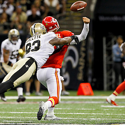 September 23, 2012; New Orleans, LA, USA; New Orleans Saints defensive end Junior Galette (93) hits Kansas City Chiefs quarterback Matt Cassel (7) as he throws to end the first half of a game at the Mercedes-Benz Superdome. Mandatory Credit: Derick E. Hingle-US PRESSWIRE