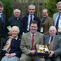 Edrington Group Malting Barley Awards 2002 Harvest<br />Edrington Group's Director of Distribution Graham Hutcheon (front centre) presents Jim and Elsie Scott with their prize for winning The Macallan (Golden Promise) award and back row from left, Tim McCreath MD of Simpsons Malt, James Frater Rrunner-up (Cutty Sark Optic), John Marshall winner (Cutty Sark Optic), David Hogg runner-up (Famous Grouse Chariot) and Ian Martin runner-up (Macallan Golden Promise)<br />see press release from Carol McLaren/Edrington Group tel: 01738 493777<br /><br />Picture by Graeme Hart.<br />Copyright Perthshire Picture Agency<br />Tel: 01738 623350  Mobile: 07990 594431