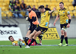 Hurricanes Jordie Barrett kicks the final penalty as his brother Beauden watches on receiving treatment against the Chiefs in the Super Rugby match at Westpac Stadium, Napier, New Zealand, Friday, April 13, 2018. Credit:SNPA / Ross Setford