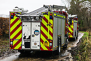 Denholm, Hawick, Scottish Borders, UK. 5th December 2015. Fire crews from Lothian & Borders in the process of rescuing several stranded horses where farmland has become submerged by the River Teviot after heavy rainfall.