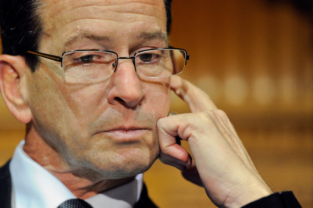 Connecticut Gov. Dannel P. Malloy wipes away a tear as he recalls how and why he decided to tell the families of the Sandy Hook Elementary School shooting that their loved ones were dead during a news conference at the Capitol in Hartford, Conn., Monday, Dec. 17, 2012. (AP Photo/Jessica Hill)