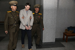 Otto Warmbier, 22, the University of Virginia student who was detained in North Korea for over a year and a half, died Monday afternoon, his parents announced. Warmbier was in a coma when he was released last week and suffered a severe neurological injury. Warmbier was traveling on a student tour of North Korea when he was arrested last year and sentenced to 15 years of hard labor for stealing a propaganda poster. PICTURED: March 16, 2016 - FILE PHOTO - Pyongyang, North Korea - American student OTTO FREDERICK WARMBIER (C) arrives for his trial in Pyongyang, capital of the Democratic People's Republic of Korea (DPRK). American student Otto Frederick Warmbier held by the Democratic People's Republic of Korea (DPRK) was sentenced to 15 years of hard labor for anti-DPRK crimes, the DPRK Supreme Court announced Wednesday. (Credit Image: © Guo Yina/Xinhua via ZUMA Wire)