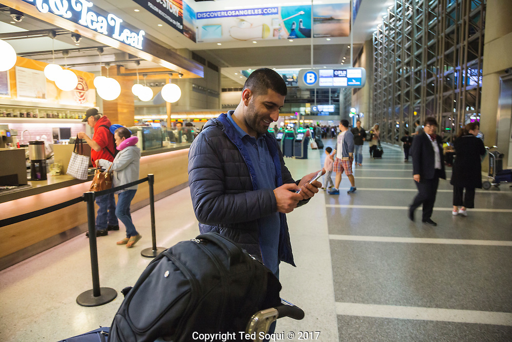 Iraqi interpreter, Alan Adil Abdullah at LAX International Terminal.<br /> Immigrants from countries on the anti-travel Muslim ban return to the US at LAX airport.