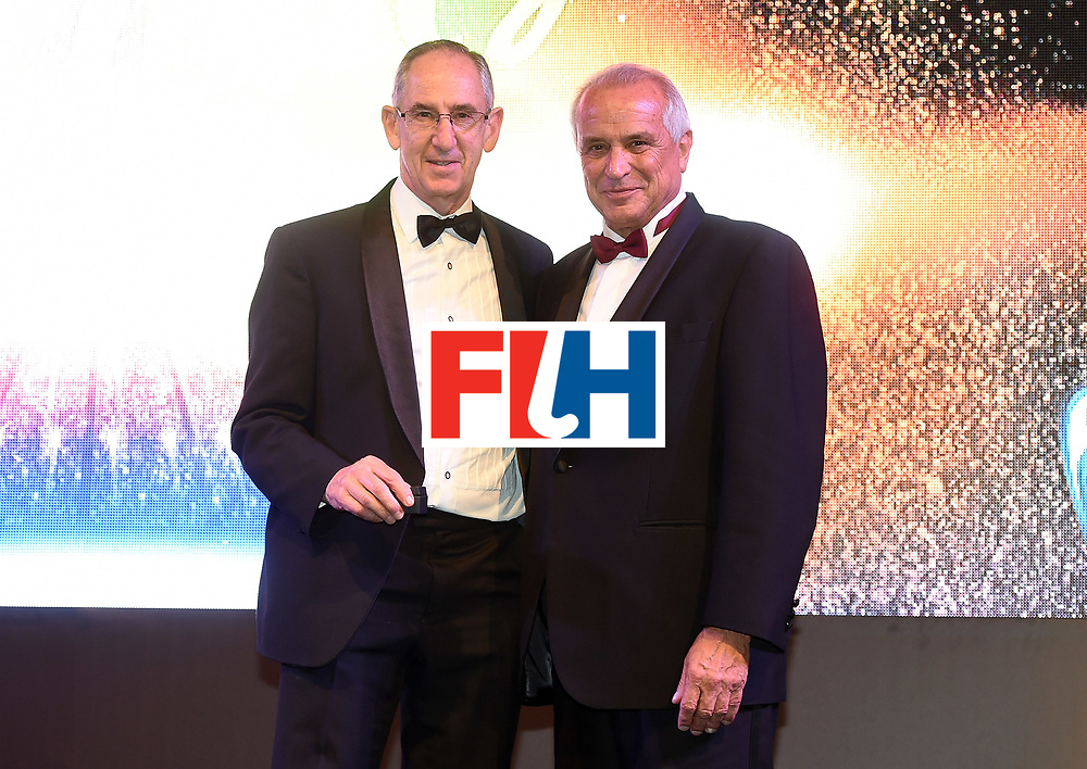 DUBAI, UNITED ARAB EMIRATES - NOVEMBER 11: Steve Jaspen recieves Diploma of Merit from Leandro Negre at the 45th FIH Congress - Hockey Revolution Part 2 No Limits Ball on November 11, 2016 in Dubai, United Arab Emirates.  (Photo by Tom Dulat/Getty Images)
