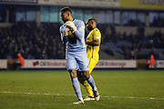 Millwall goalkeeper Jordan Archer (1) smothers ball and stops another chance during the EFL Sky Bet League 1 match between Millwall and Bristol Rovers at The Den, London, England on 12 November 2016. Photo by Matthew Redman.