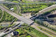 Nederland, Noord-Holland, Gemeente Ouder-Amstel, 09-04-2014; Duivendrecht, Station Duivendrecht, treinstation en metrostation. Het station ligt aan de Ringspoorbaan en de Utrechtboog. Naast het station de Sint-Urbanuskerk.<br /> Duivendrecht Railway station.<br /> luchtfoto (toeslag op standard tarieven);<br /> aerial photo (additional fee required);<br /> copyright foto/photo Siebe Swart