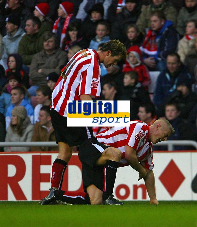 Photo: Andrew Unwin.<br />Sunderland v Luton Town. Coca Cola Championship. 09/12/2006.<br />Sunderland's Daryl Murphy (L) checks on his team-mate, Graham Kavanagh, as he lies injured.