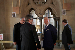 The Prince of Wales (second right) turns round after looking out from the interior view of The Queen's Diamond Jubilee Galleries, described by the late British poet John Betjeman as 'the best view in Europe', flanked by from left, the Dean of Westminster John Hall, project architect Ptolemy Dean and Jim Vincent Clerk of Works at Westminster Abbey in London.