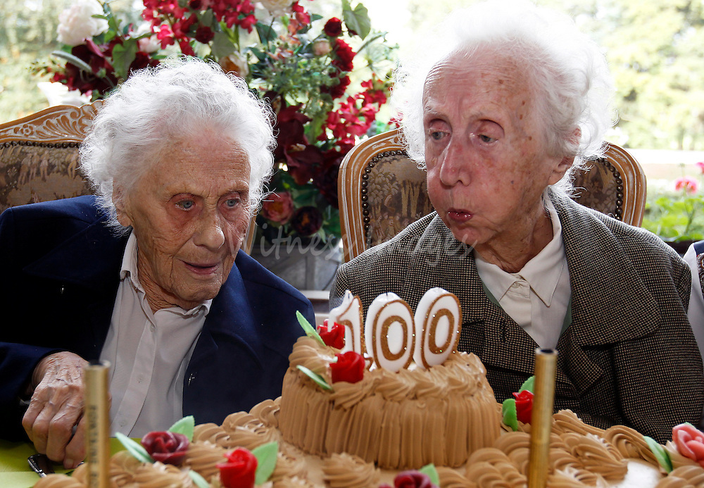 Marie (L) and Gabrielle Vaudremer, 100-year-old Belgian twins, celebrate their birthday at the Chateau Sous-Bois retirement home in Spa October 2, 2010. Marie and Gabrielle were born in 1910 and are the world's oldest pair of twin sisters, according to the Guinness World Records.   REUTERS/Thierry Roge   (BELGIUM - Tags: SOCIETY)