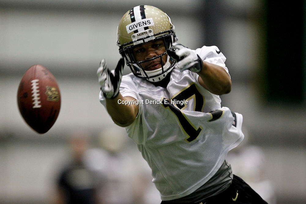 July 27, 2012; Metairie, LA, USA; New Orleans Saints wide receiver Chris Givens drops a pass during training camp at the team's indoor practice facility. Mandatory Credit: Derick E. Hingle-US PRESSWIRE
