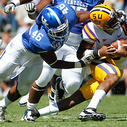 October 1, 2011; Baton Rouge, LA, USA;  Kentucky Wildcats linebacker Ronnie Sneed (46) grabs the face mask of LSU Tigers quarterback Jordan Jefferson (9) during the fourth quarter at Tiger Stadium. LSU defeated Kentucky 35-7. Mandatory Credit: Derick E. Hingle-US PRESSWIRE / © Derick E. Hingle 2011