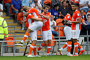 Blackpool's Brad Potts celebrates with Kyle Vassell after Potts had put the cross in that caused the own goal during the EFL Sky Bet League 2 match between Blackpool and Exeter City at Bloomfield Road, Blackpool, England on 6 August 2016. Photo by Craig Galloway.