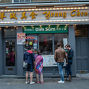 Young Cheng in London Chinatown Sweet Tooth Cafe and Restaurant at Newport Court and Garret Street on 15 June 2019, UK.